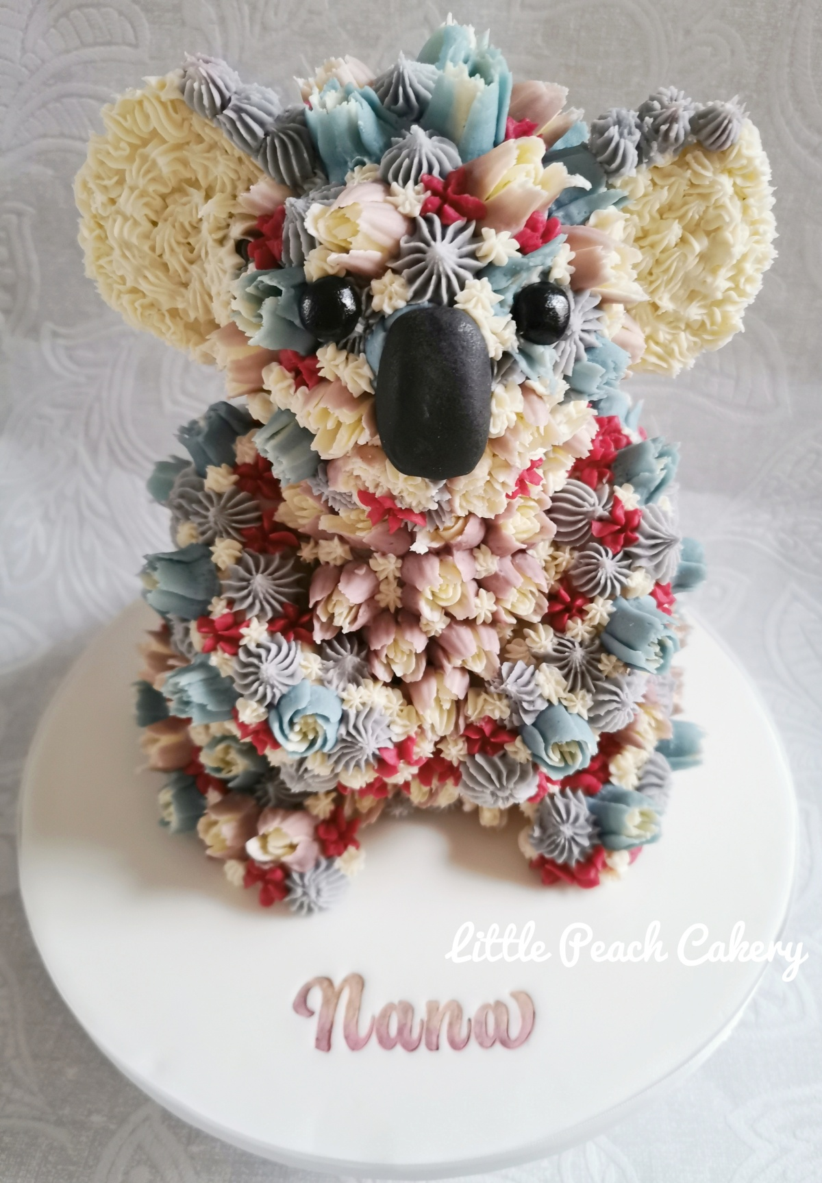 Koala cake with buttercream flowers